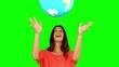 Woman throwing a globe on green screen