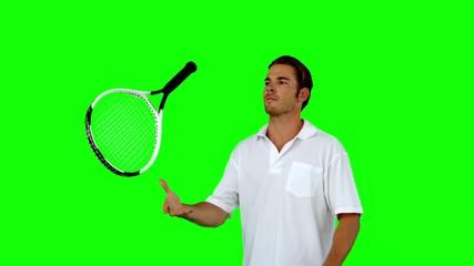 Tennis player throwing his racket