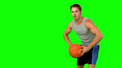 Basketball player passing the ball