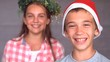 Smiling siblings with christmas hat