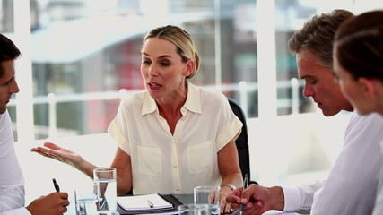 Angry businesswoman shouting at colleagues