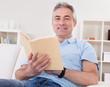 Mature Man Reading Book