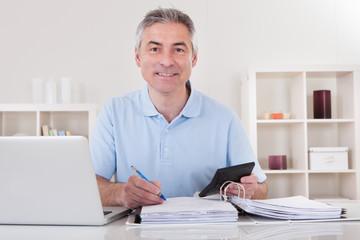 Happy Mature Man Calculating