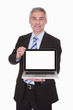 Happy Mature Businessman Presenting Laptop