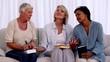 Three mature friends praying together