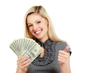 A young woman with dollars in her hands and showing ok