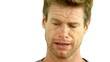 Man crying on white background