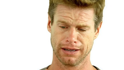 Man crying on white background
