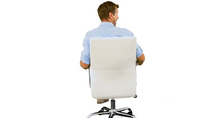 Smiling man turning on swivel chair on white background