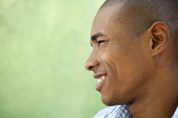 Portrait of happy young black man smiling