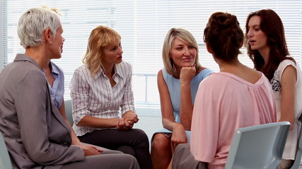 Buisnesswomen chatting in a circle