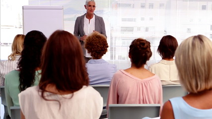 Businesswoman giving presentation to other businesswomen