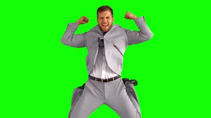 Businessman cheering and jumping