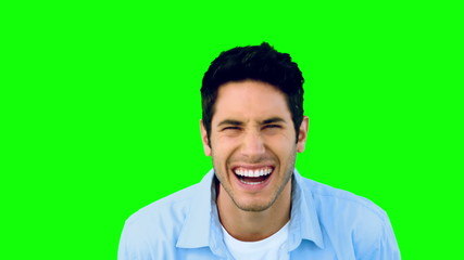 Man laughing at the camera on green screen