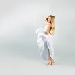 Blonde Woman in Waving White Dress