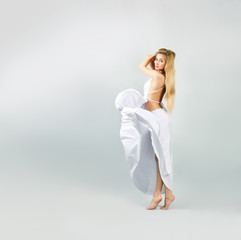 Blonde Woman in Waving White Dress