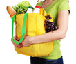 Girl with shopping bag isolated on white