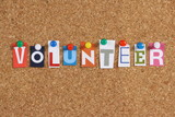 The word Volunteer on a cork notice board