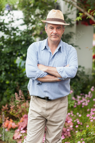 Man with a hat in the garden