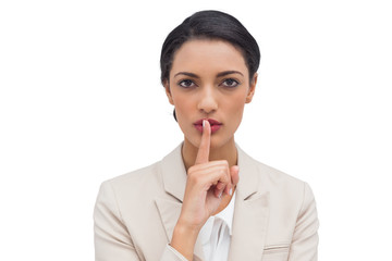 Businesswoman asking for silence