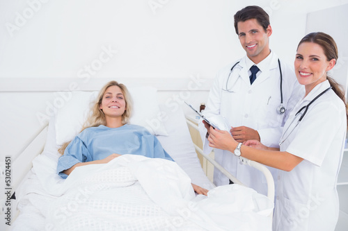Smiling patient and doctors
