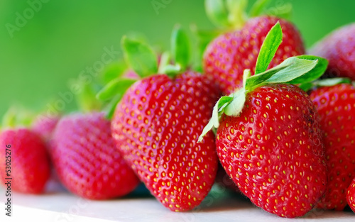 fresh strawberry on the clean green background