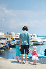 Young father and his kids at fisherman village