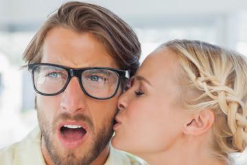 Attractive designer kissing her colleague