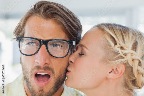 Attractive designer kissing her colleague