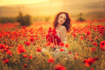 The bride  in a poppy field