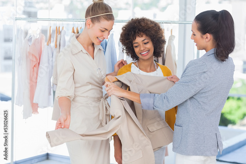 Fashion designers looking at a blazer