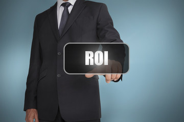 Businessman touching the word roi