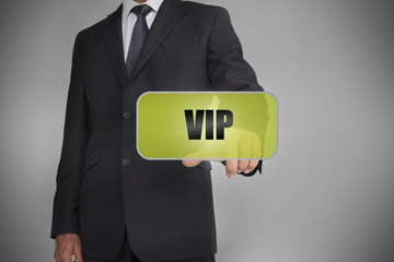 Businessman selecting green tag with the word vip written on it