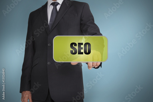 Businessman selecting green label with seo written on it