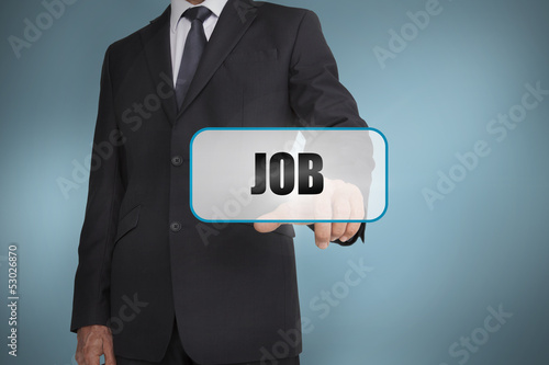 Businessman touching tag with job written on it