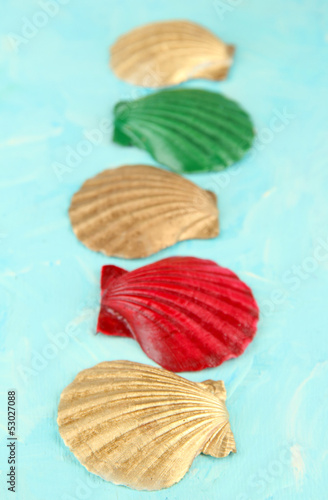 Colorful seashells on color wooden background