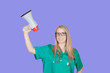Atractive medical girl with a megaphone