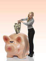 business woman savings her money dollar