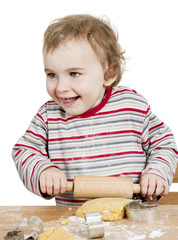 happy young child working with dough in white background
