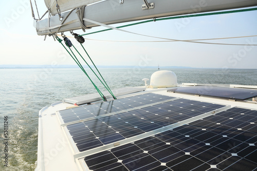 Solar Panels charging batteries aboard sail boat - 53031246