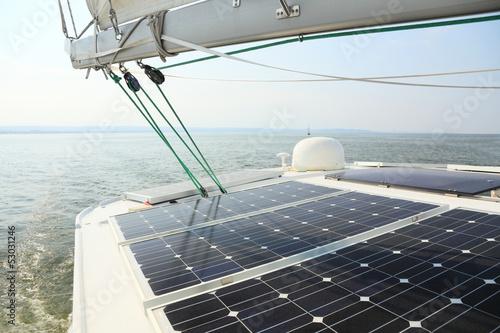 Leinwanddruck Bild Solar Panels charging batteries aboard sail boat