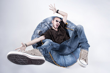 funny crazy man dressed in jeans and sneakers