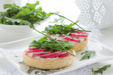 Tartlets salad with cheese and radish.