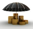 Stacks of golden coins covered by black umbrella