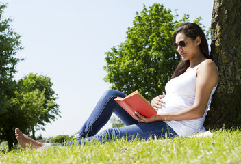 Pregnant Woman Under a Tree