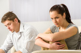 Unhappy couple sitting silently after argument