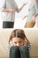 Little girl is troubled because parents arguing