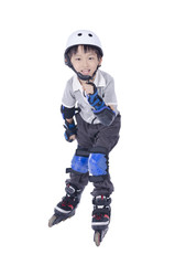 Smart boy playing roller blades over white background