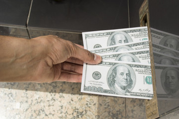 hand doing a mail in rebate dollar bills