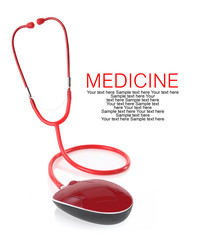Red stethoscope with computer mouse isolated on white background